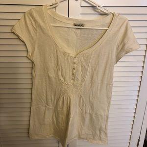 One World cream colored t shirt